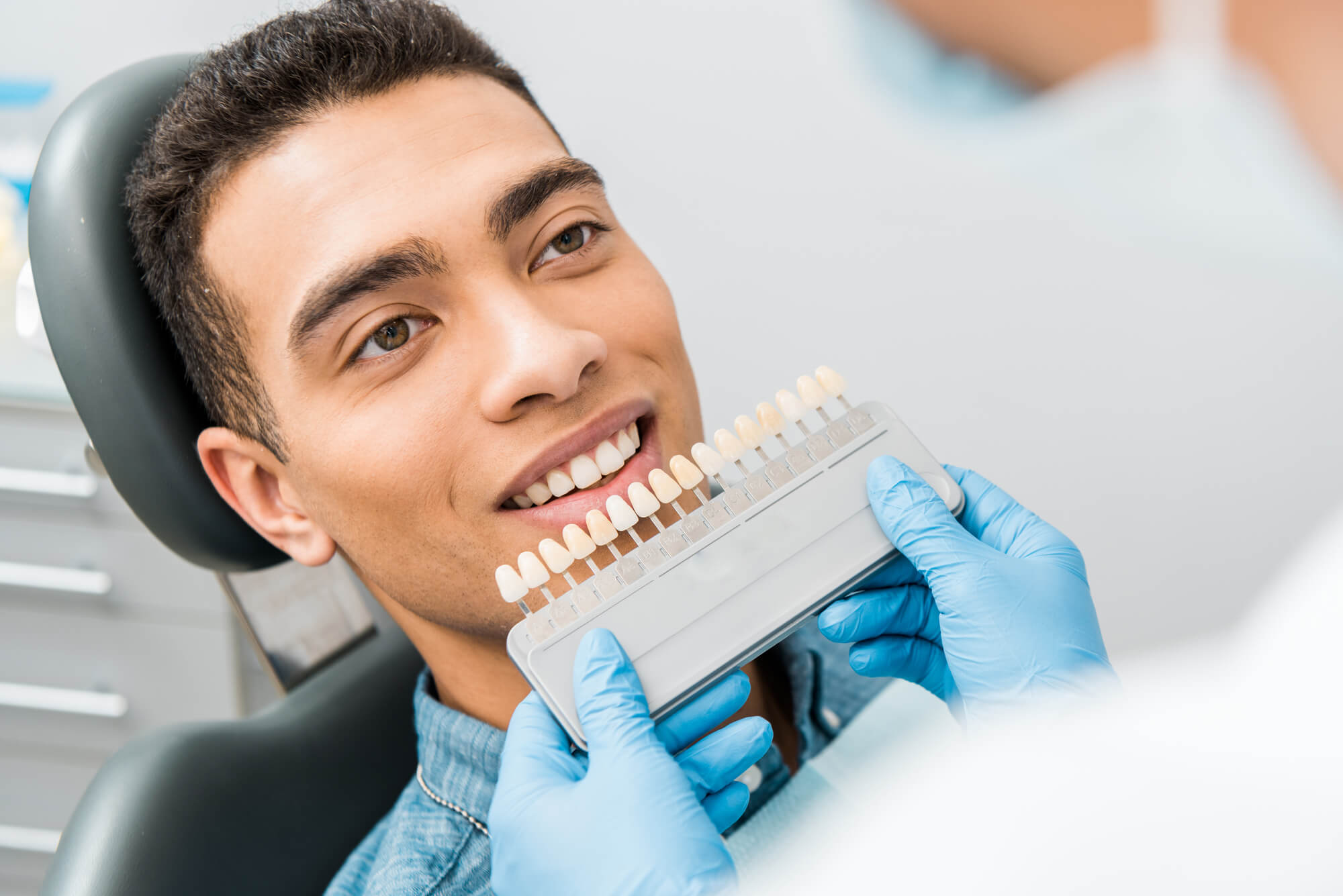 Cosmetic Dentist Fort Pierce color matches for veneers and whitening treatment
